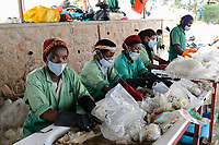 RWANDA, Kigali, plastic recycling at company ecoplastics, worker clean with solvent old plastic foils before processing to granulate which is used for new plastic products /  / RUANDA, Kigali, plastic recycling bei Firma Ecoplastics, Reinigung von alten dreckigen Folien mit Loesungsmittel , anschliessend Trocknung und Weiterverabeitung zu Plastik Granulat fuer neue Plastik Produkte