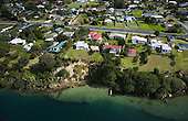 Aerial view of houses in the small settlement of Pukenui on the edge of the Houhora Harbour, Far North.Northland, New Zealand.