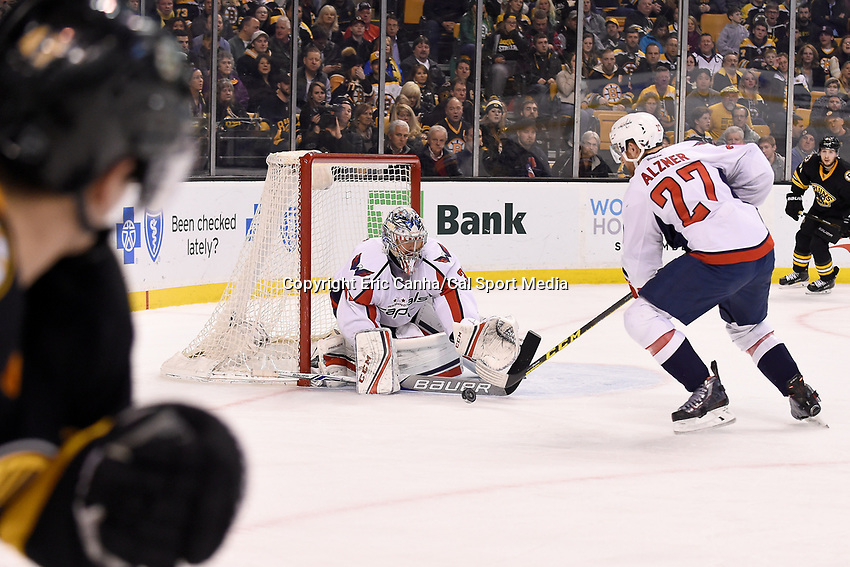 Saturday, March 5, 2016: Washington Capitals goalie Philipp Grubauer (31) makes a save during the National Hockey League game between the Washington Capitals and the Boston Bruins, held at TD Garden, in Boston, Massachusetts. Washington defeats Boston 2-1 in overtime. Eric Canha/CSM