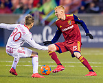 Real Salt Lake defender Justen Glad (15) keeps the ball away from New York Red Bulls midfielder Marc Rzatkowski (90) in the first half Saturday, March 17, 2018, during the Major League Soccer game at Rio Tiinto Stadium in Sandy, Utah. (© 2018 Douglas C. Pizac)