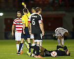 Dougie Imrie booked by ref Kevin Clancy
