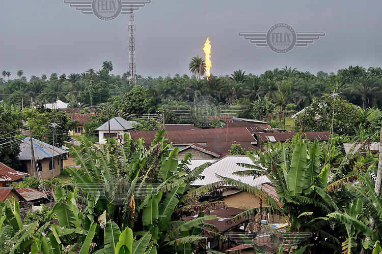 The Oshie gas flare, belonging to Agip oil company, burns in Akaraolu community. <br /> The Rumuekpe community suffered much damage during the conflict among various rival militants and cult gangs over access to oil money. The inter-communal violence killed many people, including women and children, between 2005-08. Thousands more were displaced by fighting that left homes, schools and churches in ruins with many suffering poverty and homelessness.