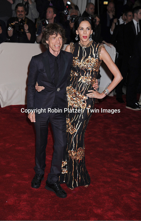 """Mick Jagger and L'Wren Scott arriving at The Costume Institute Gala Benefit celebriting """"Alexander McQueen: Savage Beauty"""" at The Metropolitan Museum of Art in New York City on May 2, 2011."""