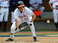 Virginia infielder Daniel Pinero (22) bunts the ball during the game Tuesday night against VCU at Davenport Stadium in Charlottesville, VA. Photo/The Daily Progress/Andrew Shurtleff