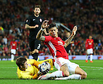 Marcos Rojo of Manchester United collides with Oleksiy Shevchenko of FC Zorya Luhansk during the UEFA Europa League match at Old Trafford Stadium, Manchester. Picture date: September 29th, 2016. Pic Matt McNulty/Sportimage