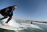 BAJA MALIBU, MX - DECEMBER 22:  surfs suring a session in Baja Malibu, Mexico on December 22, 2012.