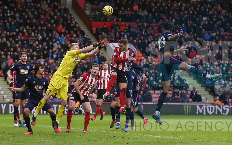 Billy Sharp of Sheffield Utd, Philip Billing of Bournemouth and Artur Boruc of Bournemouth in action during the Premier League match at Bramall Lane, Sheffield. Picture date: 9th February 2020. Picture credit should read: Chloe Hudson/Sportimage