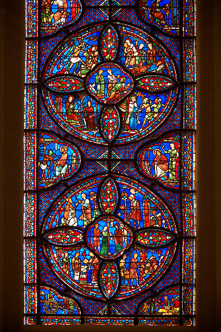 Medieval stained glass Window of the Gothic Cathedral of Chartres, France - dedicated to the life of St Anthony of the Desert.  A UNESCO World Heritage Site