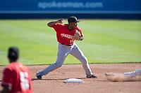 Vancouver Canadians shortstop Jesus Severino (10) prepares to make a throw to first base for a double play during a Northwest League game against the Spokane Indians at Avista Stadium on September 2, 2018 in Spokane, Washington. The Spokane Indians defeated the Vancouver Canadians by a score of 3-1. (Zachary Lucy/Four Seam Images)
