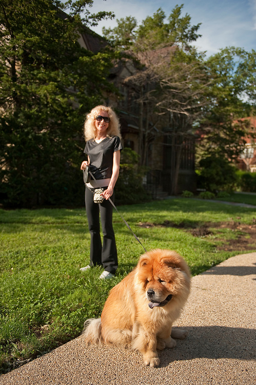 UNITED STATES - AUGUST 29:  A woman walks her Chow dog in the Forest Hills section of Queens, an area in New York's 9th Congressional district that will soon have a special election.  The election between Bob Turner (R) and David Weprin (D) will be held on September 13, 2011, to fill the seat vacated by former congressman Anthony Weiner.  (Photo By Tom Williams/Roll Call)