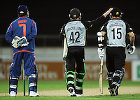India captain Mahendra Singh Dhoni watches as Nathan McCullum joins brother Brendon at the crease during 2nd Twenty20 cricket match match between New Zealand Black Caps and West Indies at Westpac Stadium, Wellington, New Zealand on Friday, 27 February 2009. Photo: Dave Lintott / lintottphoto.co.nz