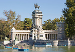 Rowing boats in boating pond of Estanque, El Retiro park, Madrid, Spain, monument to King Alfonso XII