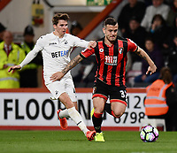 Bournemouth's Dan Gosling (L) battles with Bournemouth's Jack Wilshere (R)<br /> <br /> Bournemouth 2 - 0 Swansea<br /> <br /> Photographer David Horton/CameraSport<br /> <br /> The Premier League - Bournemouth v Swansea City - Saturday 18th March 2017 - Vitality Stadium - Bournemouth<br /> <br /> World Copyright &copy; 2017 CameraSport. All rights reserved. 43 Linden Ave. Countesthorpe. Leicester. England. LE8 5PG - Tel: +44 (0) 116 277 4147 - admin@camerasport.com - www.camerasport.com
