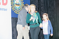 Joined by daughter Caroline, Heidi Cruz, wife of  Texas senator and Republican presidential candidate Ted Cruz, speaks before introducing her husband at a town hall at Crossing Life Church in Windham, New Hampshire, on Tues. Feb. 2, 2016. The day before, Cruz won the Iowa caucus.
