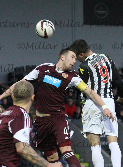 Steven Thompson beats Danny Wilson in the air in the St Mirren v Heart of Midlothian Scottish Professional Football League Premiership match played at St Mirren Park, Paisley on 29.12.13.