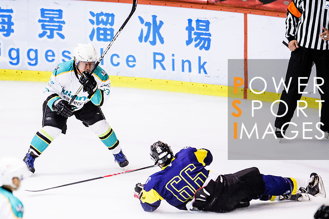 Medical Kings Skater #13 Fuk Hing So (l) battle for the puck with Verity Forward #66 Alan Chan (r) during the Principal Standard League match between Medical Winner Kings vs Verity at the Mega Ice on 17 January 2017 in Hong Kong, China. Photo by Marcio Rodrigo Machado / Power Sport Images