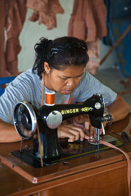 A Thai woman makes clothing out of tie dye cloth at Ben Lion, build by the Lion's Club of Thailand on  KOH PHRA THONG ISLAND after the Tsunami of 2004 - THAILAND