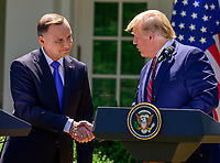 United States President Donald J. Trump, right, and President Andrzej Duda of the Republic of Poland, left, shake hands as they conduct a joint press conference in the Rose Garden of the White House in Washington, DC on Wednesday, June 12, 2019. <br /> Credit: Ron Sachs / CNP/AdMedia