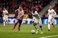 8th February 2020; Wanda Metropolitano Stadium, Madrid, Spain; La Liga Football, Atletico de Madrid versus Granada; Marcos Llorente (Atletico de Madrid) challenges for control of the ball with Ramon Azeez (Granada CF)