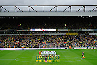 Swansea City and Norwich City players stand for a minutes silence for Remembrance Day during the Barclays Premier League match between Norwich City and Swansea City played at Carrow Road, Norwich on November 7th 2015