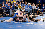 BROOKINGS, SD - DECEMBER 2:   Henry Pohlmeyer from SDSU battles with Topher Carton from Iowa in their 141 pound match Friday night at Frost Arena in Brookings, SD.(Photo by Dave Eggen/Inertia)