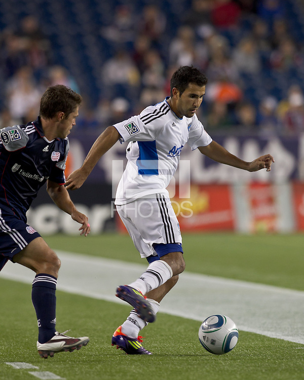 San Jose Earthquakes defender Steven Beitashour (33) dribbles under pressure. In a Major League Soccer (MLS) match, the San Jose Earthquakes defeated the New England Revolution, 2-1, at Gillette Stadium on October 8, 2011.