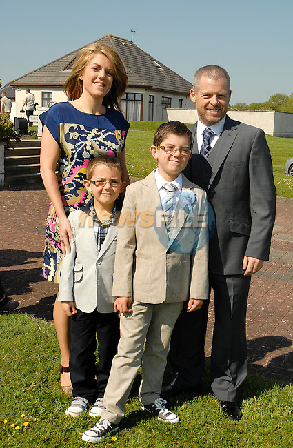 Max Russell with his parents Graham  and Yvonne and little brother Alex (6) after he made his First Holy Communion at Mornington on Saturday.