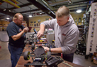 NWA Democrat-Gazette/BEN GOFF @NWABENGOFF<br /> Justin Hulce (left) of Rogers and Ray Horn, owner of NWA R/C Raceway, work on 1/10-scale radio control cars on Sunday Nov. 29, 2015 at NWA R/C Raceway in Rogers. The shop holds races most weekends for a variety of types of 1/10-scale electric vehicles on two indoor tracks.
