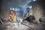 Catherine Soko and her husband prepare breakfast in their home in Dundube Kadambo, Malawi.