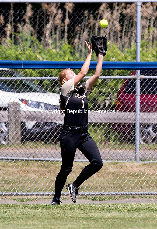 West Haven, CT- 13 June 2015-061315CM09-   Thomaston's Julia Romaniello runs back to the track to catch a fly ball against Holy Cross during the Class S state softball finals in West Haven on Saturday. Cross won, 4-0.  Christopher Massa Republican-American