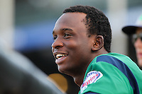 Beloit Snappers third baseman Miguel Sano #33 smiles in the dugout during a game against the Kane County Cougars at Fifth Third Bank Ballpark on June 26, 2012 in Geneva, Illinois. Beloit defeated Kane County 8-0. (Brace Hemmelgarn/Four Seam Images)
