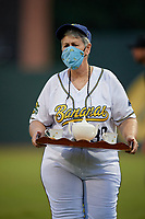 Savannah Bananas Marty Barrington (39) walks back to the dugout wearing a protective mask after delivering water to the umpires during a Coastal Plain League game against the Macon Bacon on July 15, 2020 at Grayson Stadium in Savannah, Georgia.  (Mike Janes/Four Seam Images)