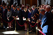 Mourners bow their heads and surround the casket of former Senator John McCain in the Capitol Rotunda where he will lie in state at the U.S. Capitol, in Washington, DC on Friday, August 31, 2018. McCain, an Arizona Republican, presidential candidate and war hero died August 25th at the age of 81. He is the 31st person to lie in state at the Capitol in 166 years.    Photo by Kevin Dietsch/UPI
