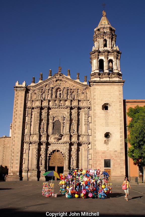 Balloon seller in front of the Templo del Carmen church in the city of San Luis de Potosi, Mexico