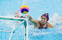 30 JUL 2012 - LONDON, GBR - Annika Dries (USA) of the USA scores in the women's London 2012 Olympic Games preliminary round water polo match against Hungary at the Olympic Park, Stratford, London, Great Britain (PHOTO (C) 2012 NIGEL FARROW)