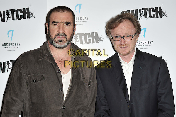 Eric Cantona and Frederic Schoendoerffer, director.The UK Premiere of 'Switch', Cineworld Haymarket, London, England. .26th March 2012.half length jacket brown beard facial hair black glasses    .CAP/MAR.© Martin Harris/Capital Pictures.