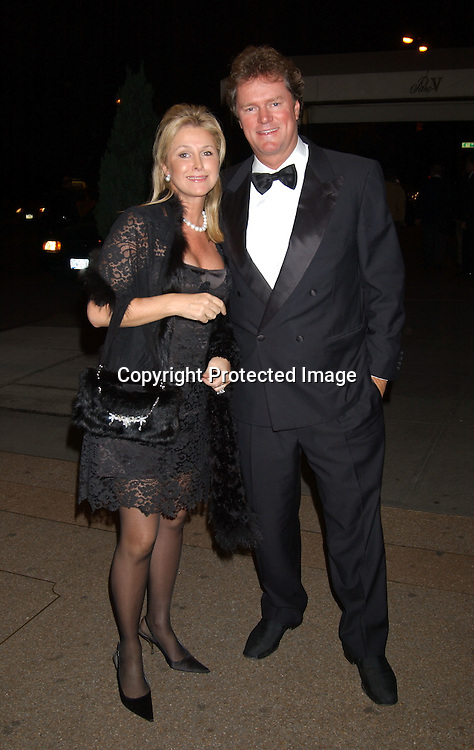 Cathy and Rick Hilton                                ..arriving at Arlene Dahl and Marc Rosen's 20th Anniversary ..party at Doubles on September 30, 2003 in New York City. ..Photo by Robin Platzer, Twin Images