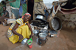 A woman makes tea in front of her makeshift shelter in a camp for more than 12,000 internally displaced persons located on the grounds of the Roman Catholic Cathedral of St. Mary in Wau, South Sudan. Most of the families here were displaced in June, 2016, when armed conflict engulfed Wau.<br /> <br /> Norwegian Church Aid, a member of the ACT Alliance, has provided relief supplies to the displaced in Wau, and has supported the South Sudan Council of Churches as it has struggled to mediate the conflict in Wau.