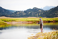 A woman casts to rising trout on Slough Creek in Yellowstone National Park.