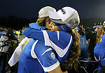 08 December 2013: UCLA's Samantha Mewis (left) and Ally Courtnall (right) embrace after the game. The Florida State University Seminoles played the University of California Los Angeles Bruins at WakeMed Stadium in Cary, North Carolina in a 2013 NCAA Division I Women's College Cup championship game. UCLA won the game 1-0 in overtime.