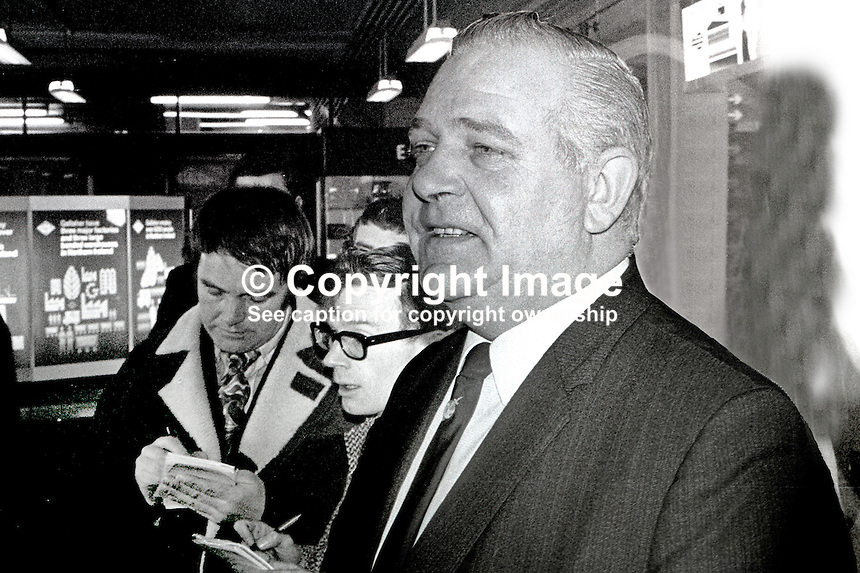 Chief Inspector Ken Drury, Scotland Yard, London, UK, on his arrival at  N Ireland's Aldergrove Airport, is quizzed by reporters. Drury had come to N Ireland to carry out an independent investigation into the death in Londonderry of Samuel Devenney, Roman Catholic, 42 years who, along with other family members, were allegedly beaten up by members of the RUC who were pursuing some young people who to escape ran through the Devenney house. Samuel died of his injuries two months later on 5th July 1969. Drury's investigation was inconclusive. He stated that he had come up against an RUC wall of silence. Drury some years later was, along with other London Metropolitan Police officers, convicted of corruption and jailed for 8 years. In the photo is David Dunseith, former police officer turned reporter for Ulster Television in 1970. 1970000127b.<br />