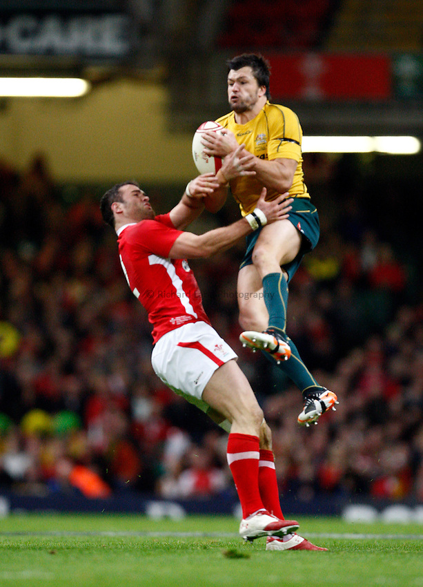 Photo: Richard Lane/Richard Lane Photography. Wales v Australia. Autumn International. 03/12/2011. Australia's Adam Ashley-Cooper wins a high ball as Wales' Jamie Roberts challenges.