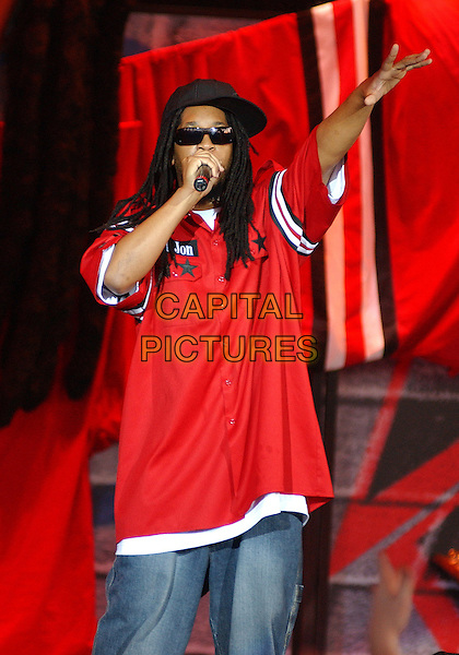 LIL JON.Live In Concert.at the Post-Gazette Pavilion,.Pittsburgh, 16th August 2005.half length stage gig rap rapper dred locks goatei beard mustache sunglasses red army military shirt denim jeans microphone hand arm.www.capitalpictures.com.sales@capitalpictures.com.© Capital Pictures.