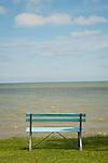 Bench along shoreline of Lake Erie.