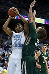 30 December 2014: North Carolina's Isaiah Hicks (22) and William and Mary's Sean Sheldon (31). The University of North Carolina Tar Heels played the College of William & Mary Tribe in an NCAA Division I Men's basketball game at the Dean E. Smith Center in Chapel Hill, North Carolina. UNC won the game 86-64.