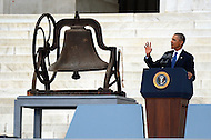 August 28, 2013  (Washington, DC)   President Barack Obama speaks at the Lincoln Memorial, August 28, 2013, next to the bell from the 16th Street Baptist Church in Birmingham, Alabama. The event recognized the 50th anniversary of the 1963 March on Washington.  (Photo by Don Baxter/Media Images International)