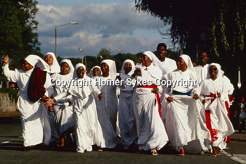 Brotherhood of the Cross and Star, Moss Side, Manchester, England. Church members have gone on an outing and crusade from London to Manchester to celebrate the 19th anniversary of the church in Britain. 1990.