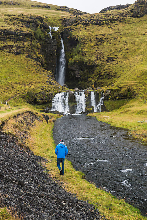 Tourist at Gluggafoss (Window Falls aka Merkjarfoss), a waterfall on the Merkja River, South Iceland (Sudurland)