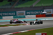 29th September 2017, Sepang, Malaysia;  Motorsports: FIA Formula One World Championship 2017, Grand Prix of Malaysia, #44 Lewis Hamilton (GBR, Mercedes AMG Petronas F1 Team), #11 Sergio Perez (MEX, Sahara Force India F1 Team),
