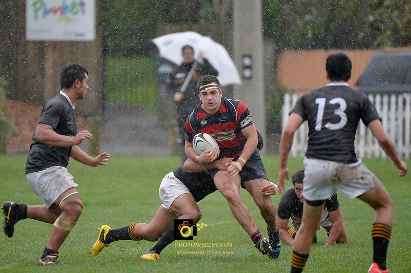 Action from the College Rugby - Hutt International Boys v Wellington College at Petone Rec, Wellington, New Zealand on Saturday 24 May 2014. <br />